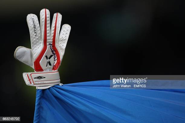 A glove rests on a flag pole indicating a reference to the infamous hand of God by Arentina's manager Diego Maradona