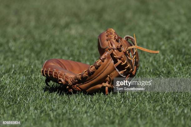 A glove rests on the turf field during batting practice before the start of the Toronto Blue Jays MLB game against the Los Angeles Angels of Anaheim...