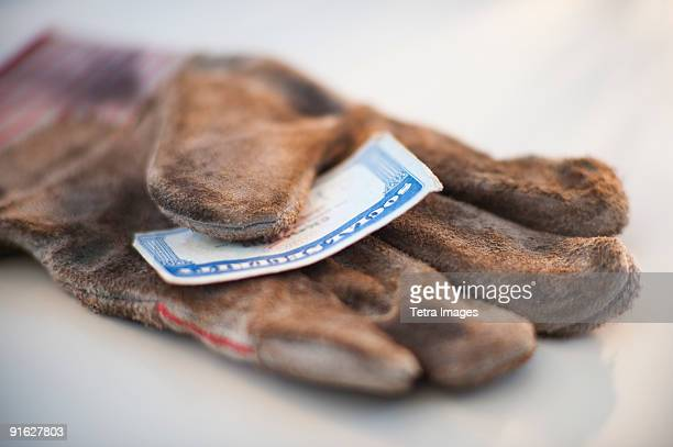 A glove with a social security card on it