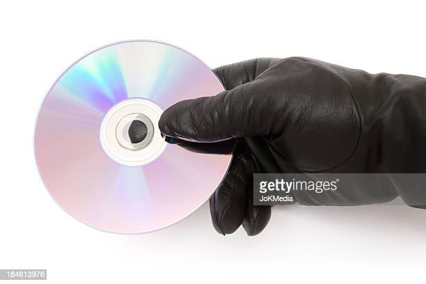 Gloved Hand Holding a CD