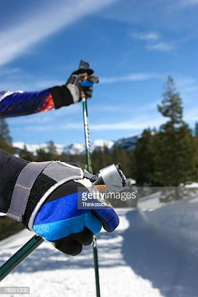 Gloved hands and ski poles