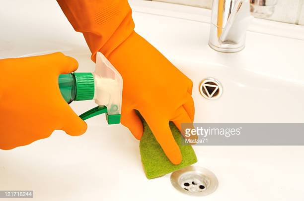 gloved hands cleaning a drain in a bathroom - drain cleaner stock photos and pictures
