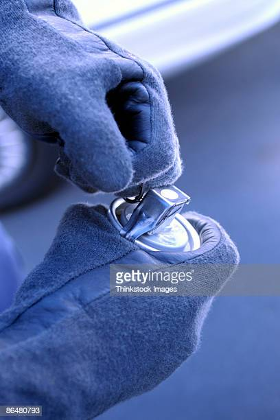 gloved hands holding tear gas grenade - tear gas fotografías e imágenes de stock