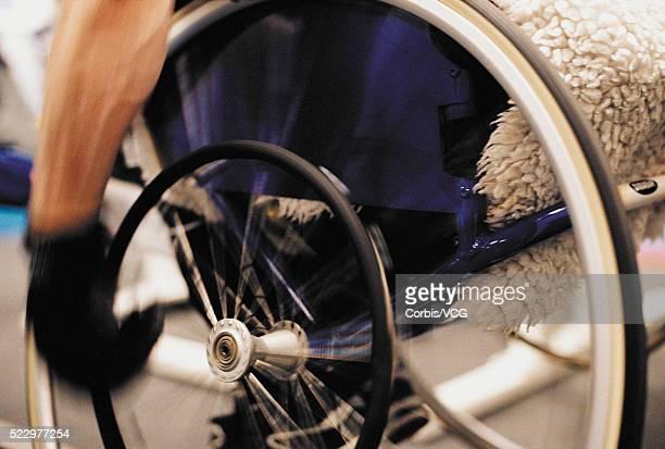 Gloved Wheelchair User