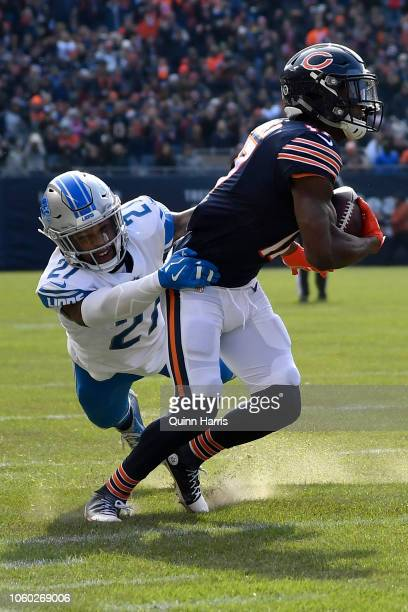 Glover Quin of the Detroit Lions attempts to tackle Anthony Miller of the Chicago Bears in the second quarter at Soldier Field on November 11 2018 in...