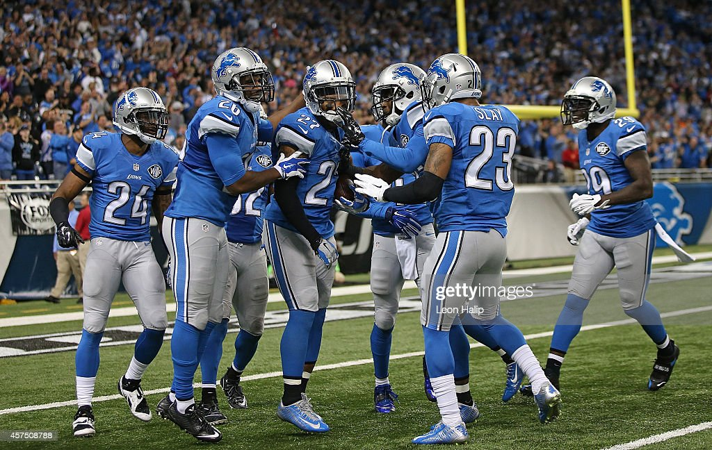 Glover Quin #27 of the Detroit Lions celebrates with his teammates after the interception off Dree Brees (not in photo) during the game at Ford Field on October 19, 2014 in Detroit, Michigan. The Lions defeated the Saints 24-23.
