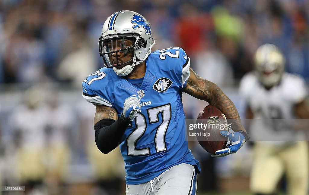Glover Quin #27 of the Detroit Lions runs back the fourth quarter interception off Dree Brees (not in photo) during the game at Ford Field on October 19, 2014 in Detroit, Michigan. The Lions defeated the Saints 24-23.