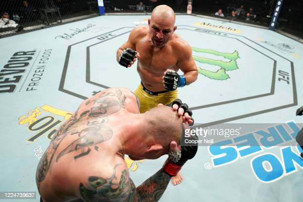 Glover Teixeira of Brazil fights Anthony Smith in their light heavyweight bout during the UFC Fight Night Event at VyStar Veterans Memorial Arena on...