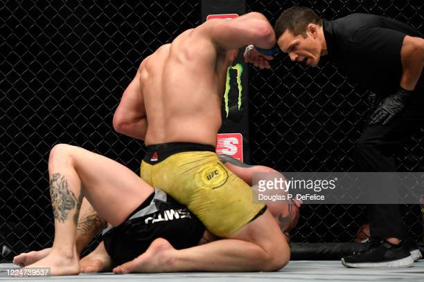 Glover Teixeira of Brazil fights Anthony Smith of the United States in their Light Heavyweight bout during UFC Fight Night at VyStar Veterans...