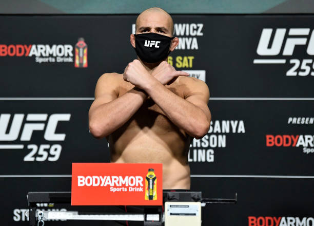 Glover Teixeira of Brazil poses on the scale during the UFC 259 weigh-in at UFC APEX on March 05, 2021 in Las Vegas, Nevada.