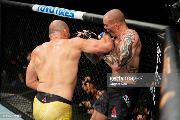 Glover Teixeira of Brazil punches Anthony Smith in their light heavyweight bout during the UFC Fight Night Event at VyStar Veterans Memorial Arena on...