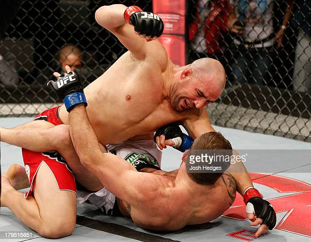 Glover Teixeira punches Ryan Bader in their light heavyweight fight during the UFC on FOX Sports 1 event at Mineirinho Arena on September 4 2013 in...