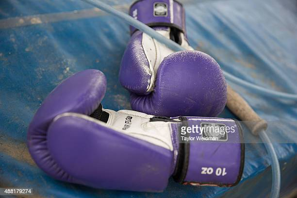 Gloves and a jumprope at a small Muay Thai gym in front of Rose's home on September 14 2015 in Phimai Thailand Somros 'Rose' Pholjaroen is a...