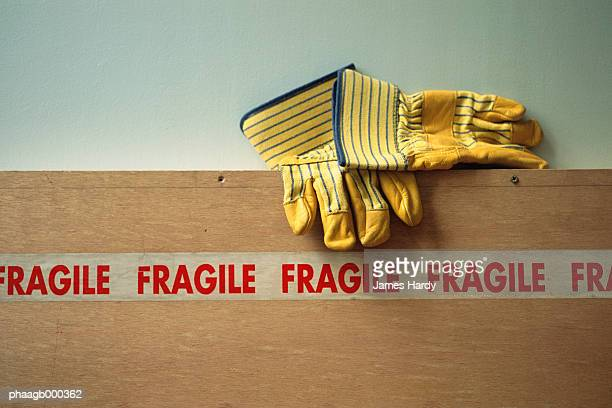 gloves and fragile tape - fragile sign stock pictures, royalty-free photos & images