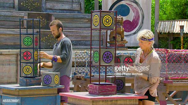 Gloves Come Off Vytas Baskauskas and Tina Wesson compete in the Redemption Challenge during the eleventh episode of SURVIVOR BLOOD vs WATER Wednesday...