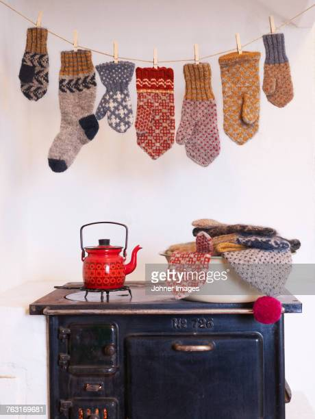 Gloves hanging above stove