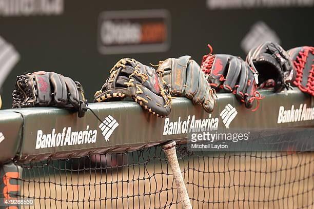 Gloves lined up on the dug post before a baseball game between Baltimore Orioles and the Texas Rangers at Oriole Park at Camden Yards on July 2 2015...
