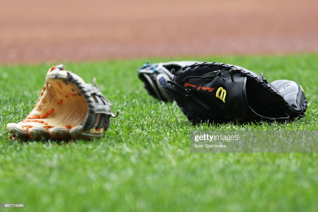 Gloves litter the field prior to a game between the Milwaukee Brewers and the New York Mets on May 13, 2017 at Miller Park in Milwaukee, Wi.