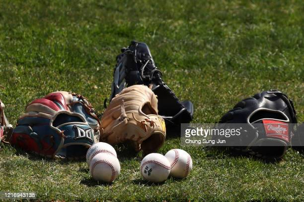 Gloves of LG Twins team players ahead of their intrateam game to be broadcasted online for their fans at a empty Jamshil baseball stadium as South...