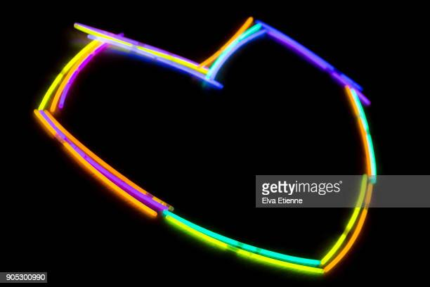 Glow sticks laid out in the shape of a heart