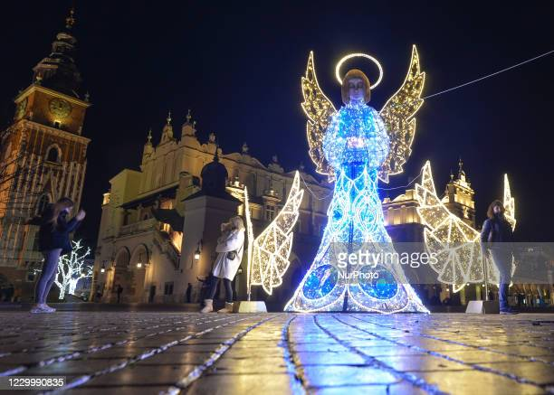 Glowing angels Christmas decorations seen in Krakow's Main Market Square. On Sunday, December 6 in Krakow, Poland.