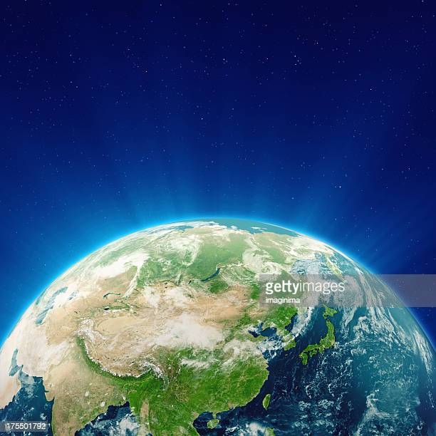 glowing blue earth china, japan and far east - china east asia stock pictures, royalty-free photos & images
