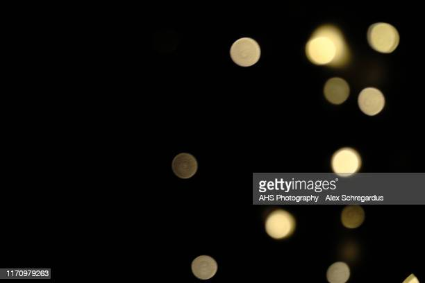 glowing bokeh lights background with copy space - defocussed stock pictures, royalty-free photos & images
