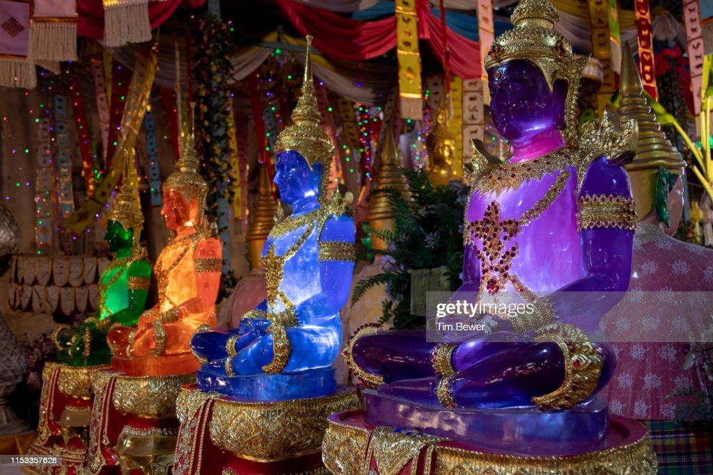Glowing Buddha statues. : Stock Photo