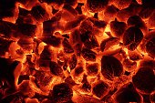 Glowing Charcoal Briquettes Background Texture