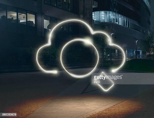 Glowing cloud symbol surrounding circle in city at night