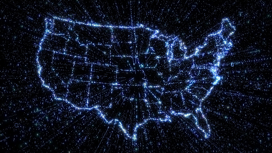 Glowing digital map of USA with exploding binary data 1030916614