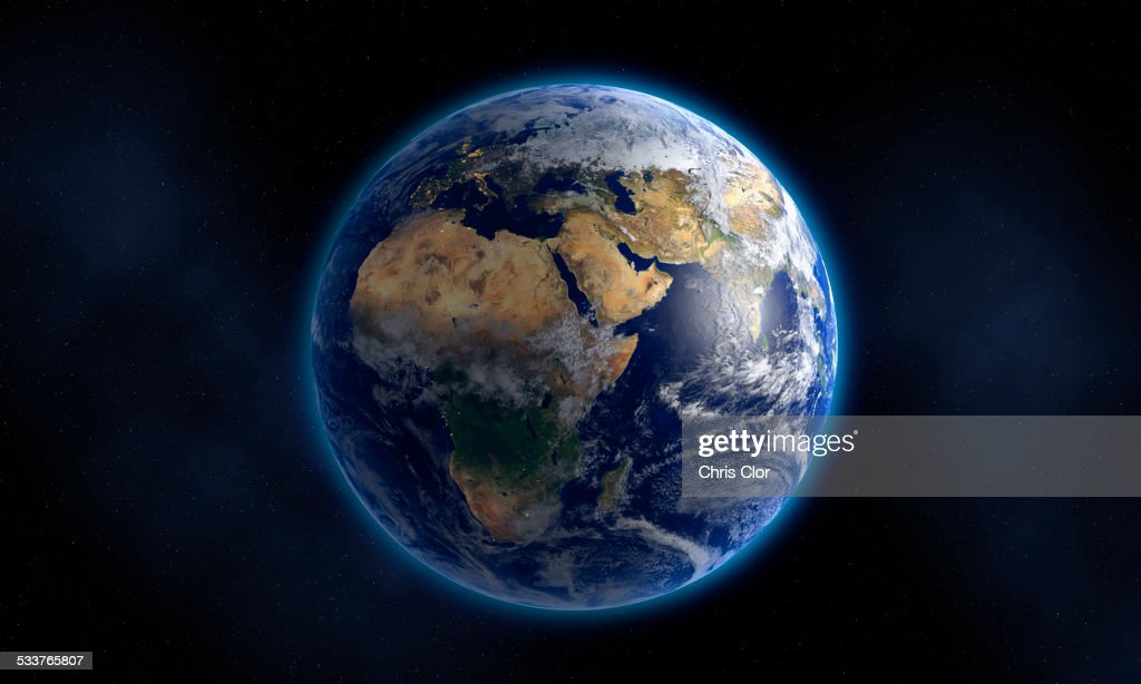 Glowing Earth floating in space : Stock Photo