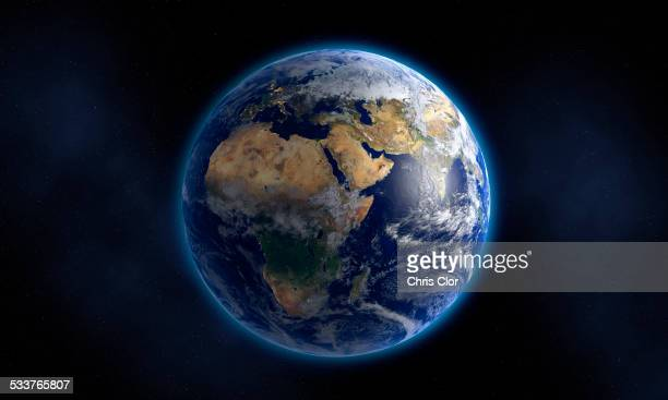 glowing earth floating in space - copy space stockfoto's en -beelden