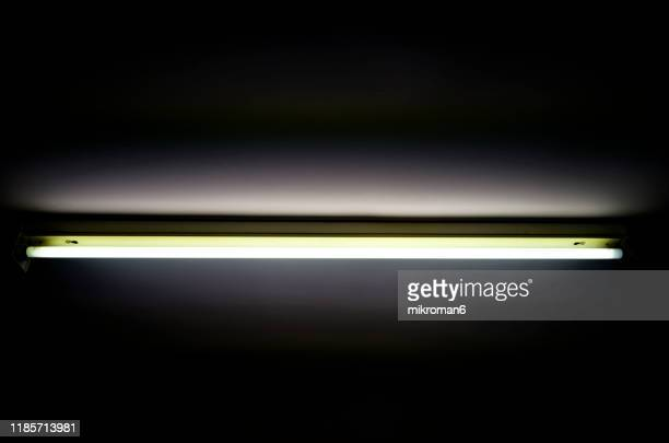 glowing fluorescent, strip light, glow tube - fluorescent stock pictures, royalty-free photos & images