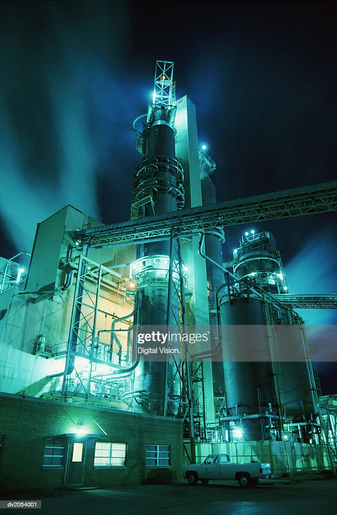 Glowing Industrial Plant at Night : Stock Photo