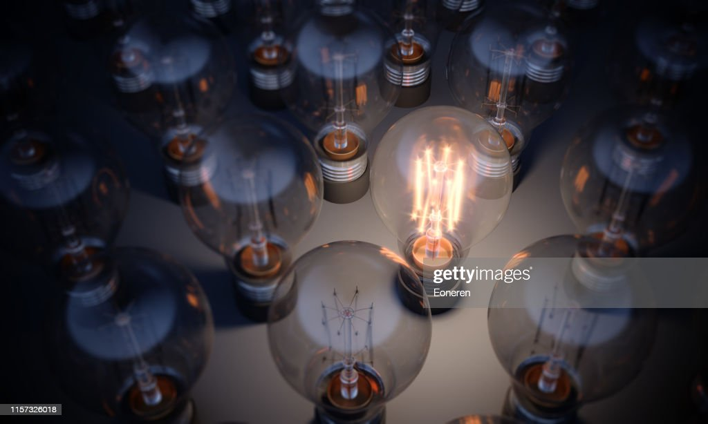 Glowing Light Bulb Standing Out From the Crowd : Stock Photo