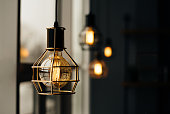 Glowing light bulbs in the loft style