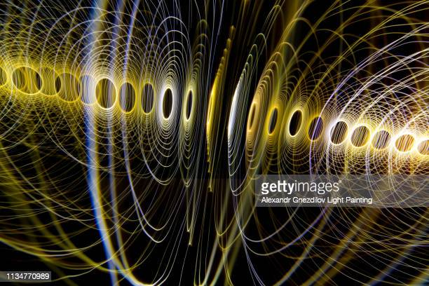 glowing light spiral (light painting) - radio wave stock pictures, royalty-free photos & images