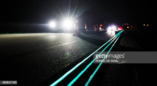 Glowing Lines at a highway near Oss The Netherlands are pictured on April 10 2014 The road marking absorb daylight during the day and gives light in...