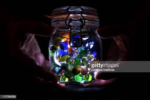 glowing marble jar - catherine macbride ストックフォトと画像