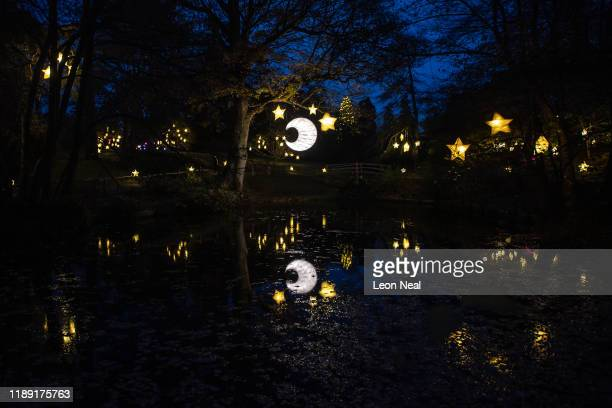 A glowing moon and stars are seen suspended over a pool at Wakehurst Kew's wild botanic gardens during the launch of the winter lantern trail on...
