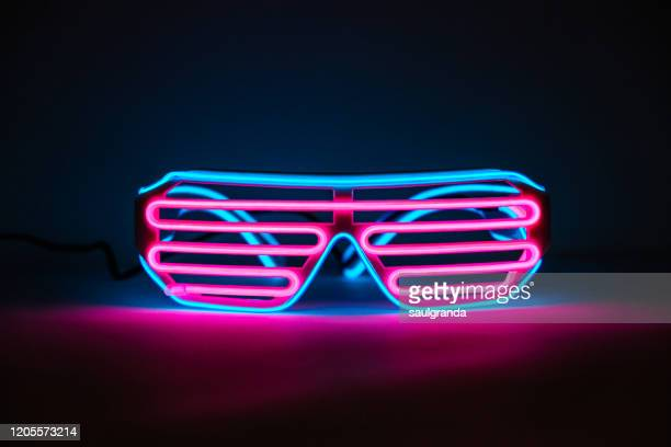 glowing neon glasses - arts culture and entertainment stock pictures, royalty-free photos & images