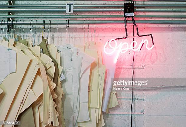 Glowing open sign in fashion studio