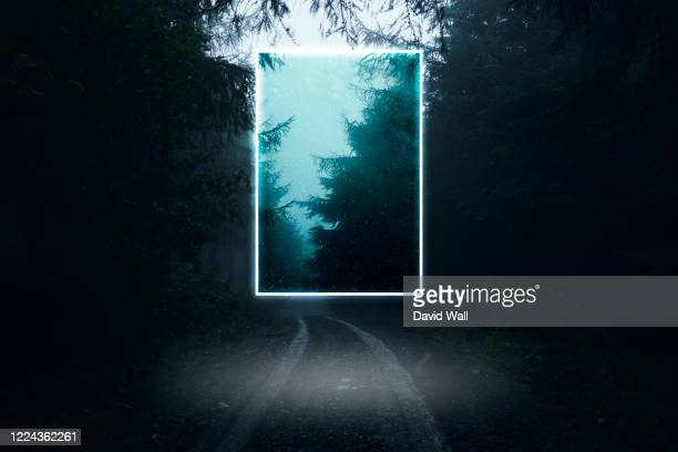 a glowing, portal, gateway floating above a track in a spooky misty forest, science fiction concept. - escaping stock pictures, royalty-free photos & images