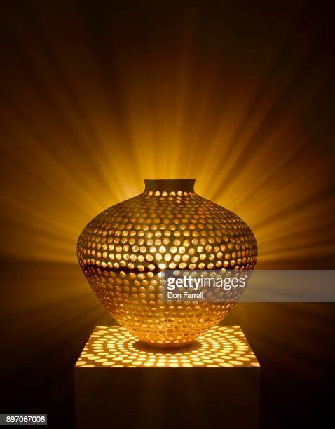 glowing pot - don farrall stock pictures, royalty-free photos & images