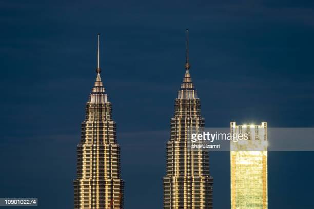 Glowing skyscrapers over sunrise in Kuala Lumpur, Malaysia.