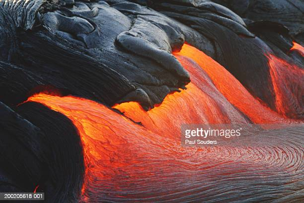glowing streams of lava pouring during eruption of kilauea volcano - lava stock pictures, royalty-free photos & images