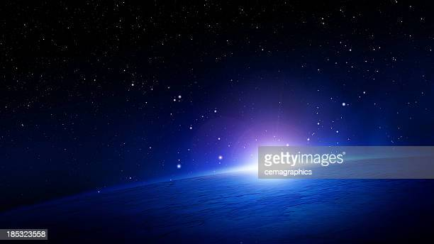 glowing sunlight over the horizon on planet earth in space - nebula stock pictures, royalty-free photos & images