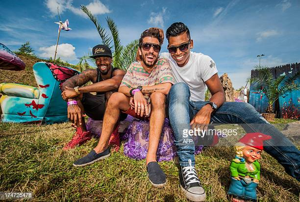 Glow-in-the-dark dubstep group poses during the third day of the ninth edition of the Tomorrowland music festival on July 28 2013, in Boom. AFP PHOTO...