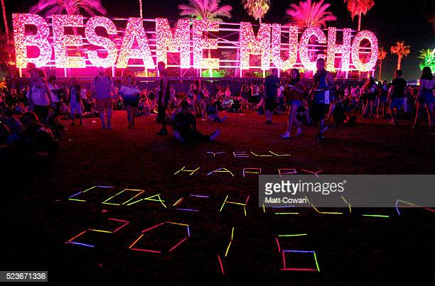 Glowinthedark lettering as seen with Besame Mucho art installation by R R Studios during day 2 of the 2016 Coachella Valley Music Arts Festival...